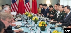 US Secretary of State Rex Tillerson(center left), and US Secretary of Defense Jim Mattis (obscured), hosts Chinese State Councilor Yang Jiechi, and Chief of the People's Liberation Army Joint Staff Department General Fang Fenghui, right, as the two countries start the US-China Diplomatic and Security Dialogue, June 21, 2017, in Washington.