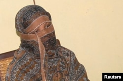 FILE - Pakistani Christian woman Asia Bibi is seen after a meeting with the governor of Punjab province at a jail in Sheikhupura, Pakistan.