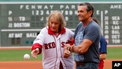 FILE - About to turn 100-years-old, Babe Ruth's daughter Julia Ruth Stevens throws out the ceremonial first pitch with help from her son Tom before a baseball game between the Boston Red Sox and the Tampa Bay Rays at Fenway Park in Boston, Saturday, July