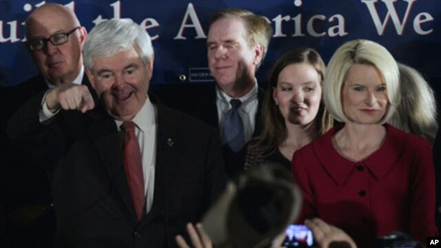 Republican presidential candidate and former House Speaker Newt Gingrich arrives with his wife Callista during his South Carolina primary rally in Columbia, South Carolina. January 21, 2012.