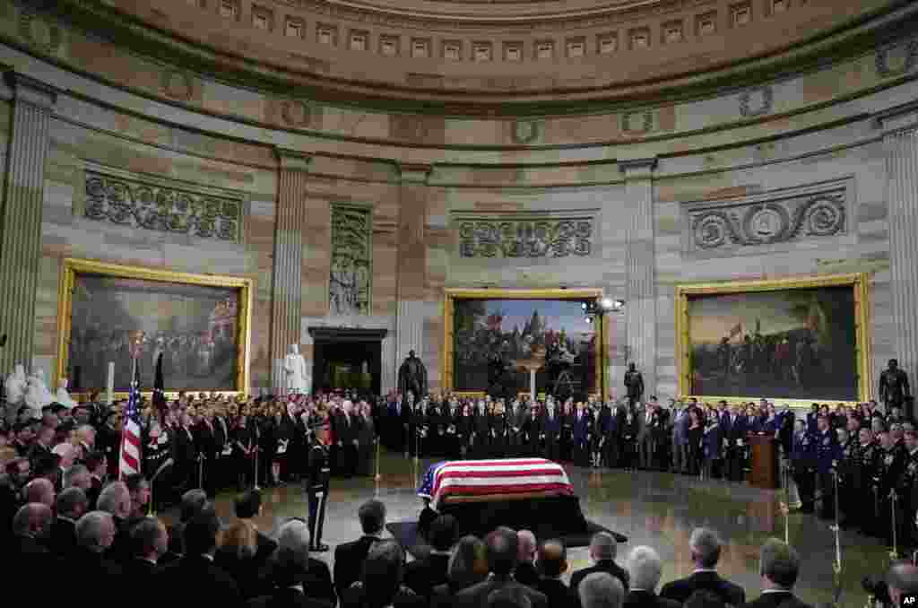 The flag-draped casket of former President George H.W. Bush lays inside the Rotunda of the Capitol in Washington, Dec. 3, 2018.
