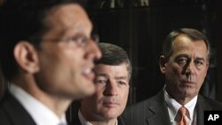 House Speaker John Boehner, right, and Republican Conference Chairman Representative Jeb Hensarling, center, listen as House Majority Leader Eric Cantor, left, speaks during a news conference on Capitol Hill in Washington, July 26, 2011