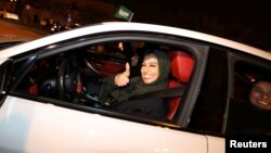 A Saudi woman drives her car in her neighborhood, in Al Khobar, Saudi Arabia, June 24, 2018.