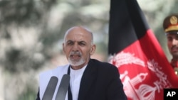 FILE - Afghan President Ashraf Ghani Ahmadzai talks during a news conference in Kabul, Oct. 3, 2014.