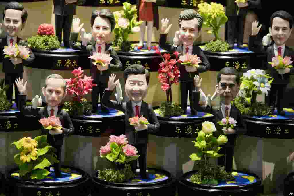 Clay figures, showing U.S. President Barack Obama, Chinese President Xi Jinping and Russian President Vladimir Putin amongst other state leaders expected to attend the G20 summit are displayed at a shop in Hangzhou in eastern China's Zhejiang province.