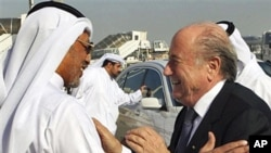 FIFA president Sepp Blatter (R) is greeted by AFC president Mohammed bin Hammam upon his arrival at the airport in Doha for an official visit to Qatar, 16 Dec 2010
