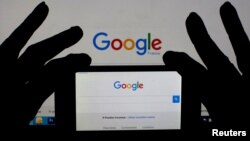 A smartphone and computer screen display the Google home page. Australia is one step closer to forcing tech firms to give police access to encrypted data.