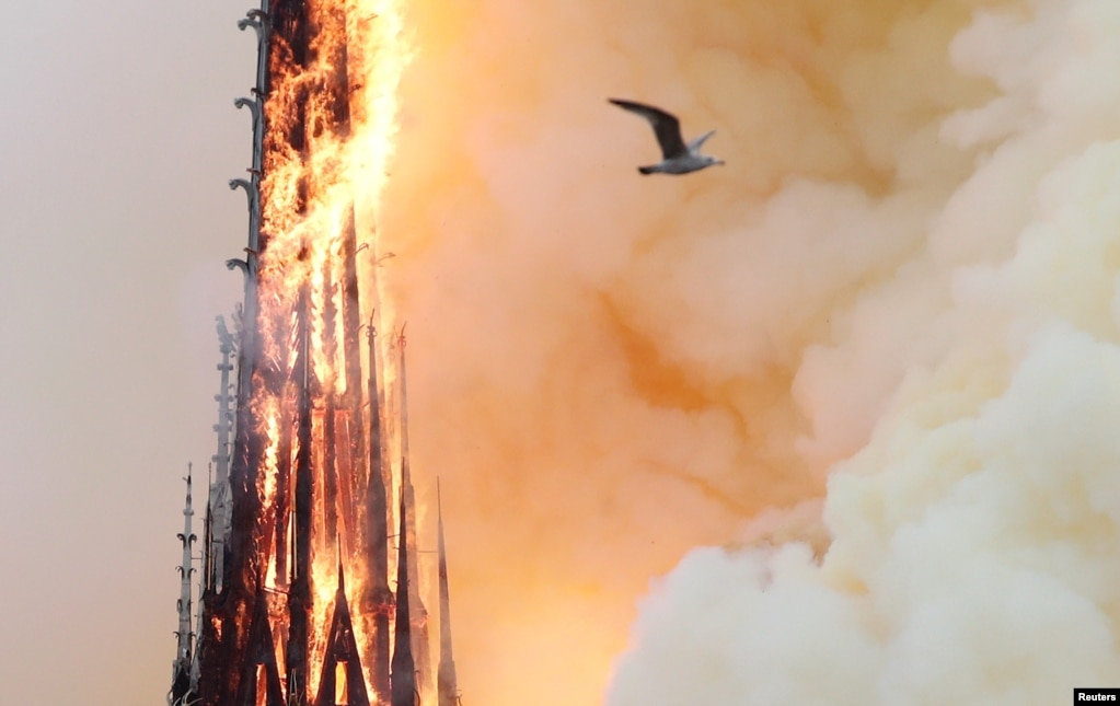 Smoke rises as fire spreads through the spireof Notre-Dame Cathedral in Paris, France, April 15, 2019.