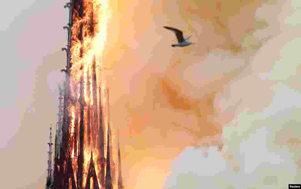 Smoke rises as fire spreads through the spire of Notre-Dame Cathedral in Paris, France, April 15, 2019.