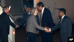 India Britain: Britain's Prime Minister Theresa May, centre, is welcomed by an official upon her arrival at the Palam airport in New Delhi, India, Sunday, Nov. 6, 2016.