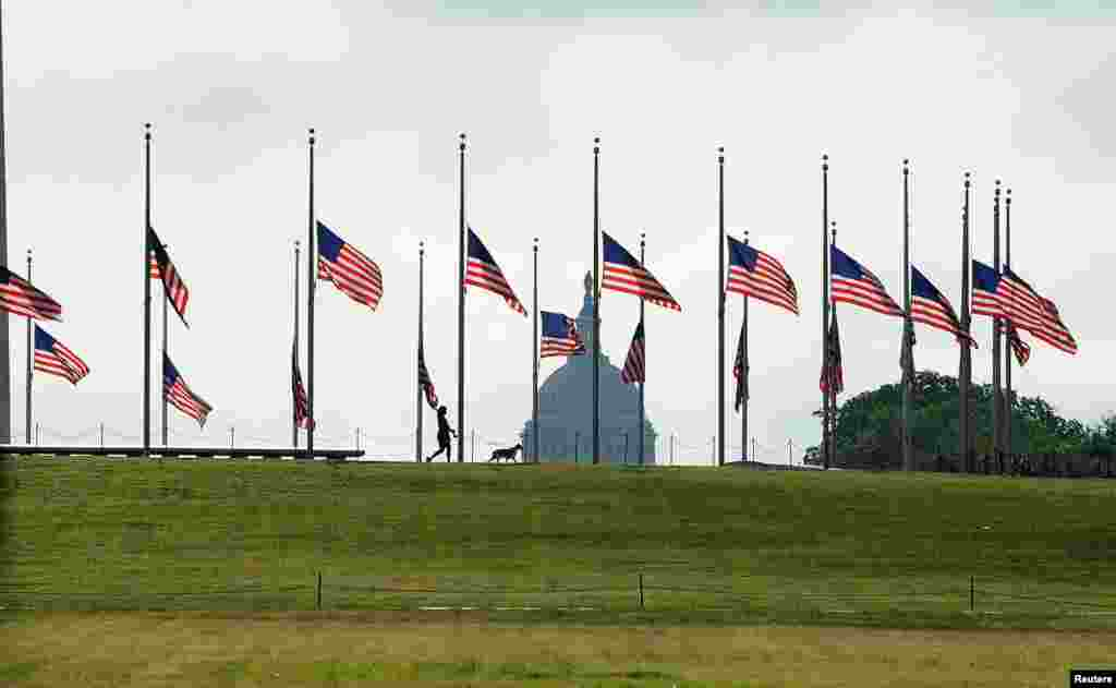 U.S. flags fly at half-staff on the National Mall to commemorate the victims of the coronavirus disease (COVID-19) in Washington, D.C., May 23, 2020.