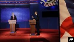 Republican presidential nominee Mitt Romney (l) debates President Barack Obama at the University of Denver, Oct. 3, 2012, in Denver