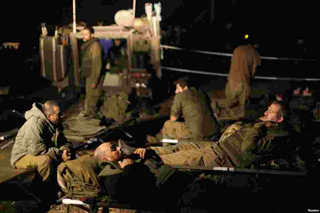 Israeli soldiers rest at a staging area outside the northern Gaza Strip, Nov. 21, 2012.