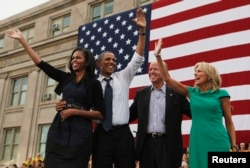 U.S. President Barack Obama, first lady Michelle Obama, U.S. Vice President Joseph Biden, and his wife, Dr. Jill Biden, all wave after Obama speaks at a campaign event at the University of Iowa's Jessup Hall Lawn in Iowa City, Iowa, September 7, 2012.