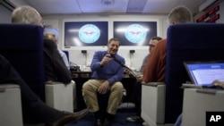 Defense Secretary Leon Panetta briefs the media on board a plane en route to a NATO conference in Brussels, Belgium, Feb. 1, 2012.