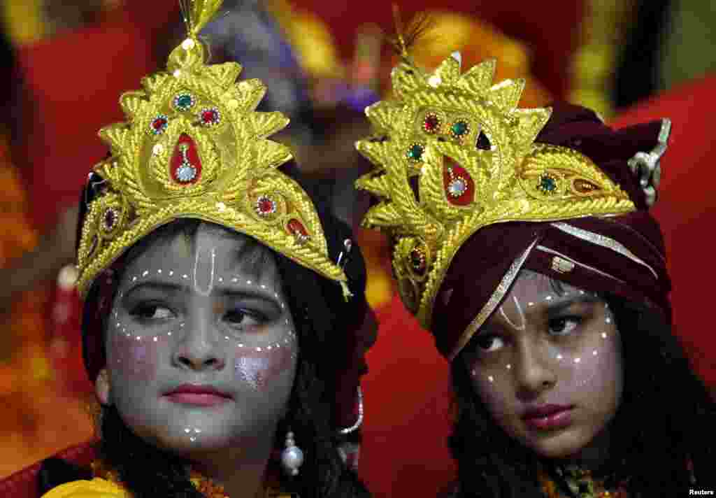 Children dressed as Hindu Lord Krishna wait to participate in a fancy dress competition at a temple in Chandigarh, India.