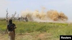 Khói bốc lên sau một cuộc không kích tại Syria.