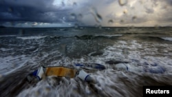 The remains of a dinghy, used by immigrants, is seen during a storm in Kos island, Greece, early May 29, 2015.