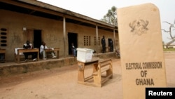 FILE - A sign for Ghana's Electoral Commission is seen at a voting station in Accra during a previous poll.