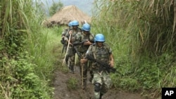 United Nations peacekeepers patrol near their encampment in the village of Kimua in the east of DRC.