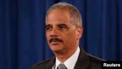 FILE - U.S. Attorney General Eric Holder makes a statement about the grand jury decision not to seek an indictment in the Staten Island death of Eric Garner during an arrest in July, in Washington, Dec. 3, 2014.
