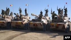 Tentara Chadian siaga di kota Gamboru, Nigeria (1/2). Bentrokan dengan militan Boko Haram menewaskan sedikitnya 13 tentara Chad.