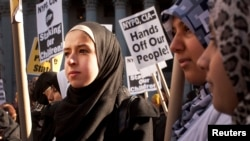 FILE - Muslim women protest against alleged heavy-handedness on the part of the New York Police Department (NYPD).