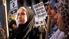 FILE - Muslim women protest against alleged heavy-handedness on the part of the New York Police Department.