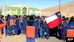 Workers at Escondida mine, owned by Australia-based BHP Billiton, protest outside mine compound, Antofagasta, Chile, August 14, 2013.