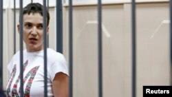 FILE - Ukrainian army pilot Nadiya Savchenko speaks inside a defendants' cage as she attends a hearing at the Basmanny district court in Moscow, Feb. 10, 2015.