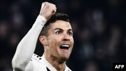 Juventus' Portuguese forward Cristiano Ronaldo celebrates after scoring 2-0 during the UEFA Champions League round of 16 second-leg football match Juventus vs Atletico Madrid on March 12, 2019 at the Juventus stadium in Turin. (Photo by Marco BERTORELLO /