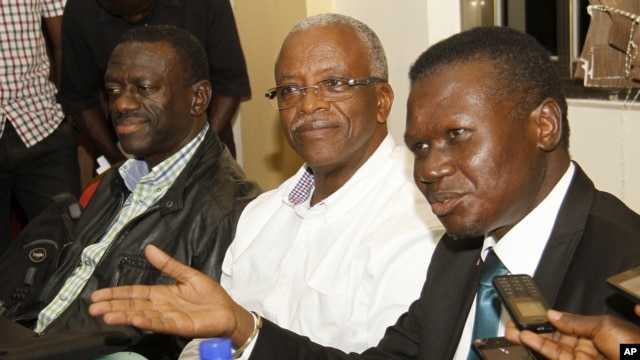 FILE - Uganda opposition leaders, from left to right: Forum for Democratic Change, Dr. Kizza Besigye, former Prime Minister Amama Mbabazi and Democratic Party President Norber Mao meet at the Democratic Alliance office in Kampala, Sept. 18, 2015.