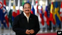 FILE - India's Vice President M. Venkaiah Naidu arrives for the ASEM 12 in Brussels, Oct. 18, 2018.