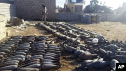 Weapons and explosives confiscated by Iraqi security forces from Islamic State militants are on display Dec. 22, 2015, at an Iraqi army base as security forces advance their position in northern Ramadi, west of Baghdad, Iraq.