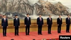 China's new Politburo Standing Committee members (L-R) Han Zheng, Wang Huning, Li Zhanshu, Xi Jinping, Li Keqiang, Wang Yang and Zhao Leji, line up as they meet with the press at the Great Hall of the People in Beijing, China October 25, 2017.