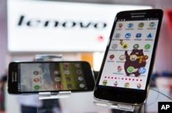 FILE - Lenovo shows its Vibe X smartphones at a trade fair in Berlin, Sept. 5, 2013.