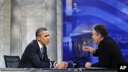 President Barack Obama talks with host Jon Stewart as he takes part in a taping of Comedy Central's The Daily Show with Jon Stewart, 27 Oct 2010, in Washington