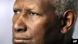 Abdou Diouf, Secretary General of the International Francophone Organization, looks on during the closing news conference, File October 24, 2010.