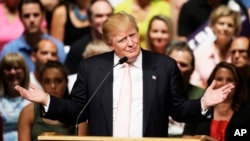 Republican presidential candidate Donald Trump speaks at a rally and picnic in Oskaloosa, Iowa, July 25, 2015.