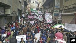 Demonstrators gather during a protest against Syria's President Bashar al-Assad after Friday prayers in Yabroud near Damascus March 2, 2012.