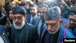 Afghan former President Hamid Karzai and Head of Political Office of the Taliban Sher Mohammad Abbas...