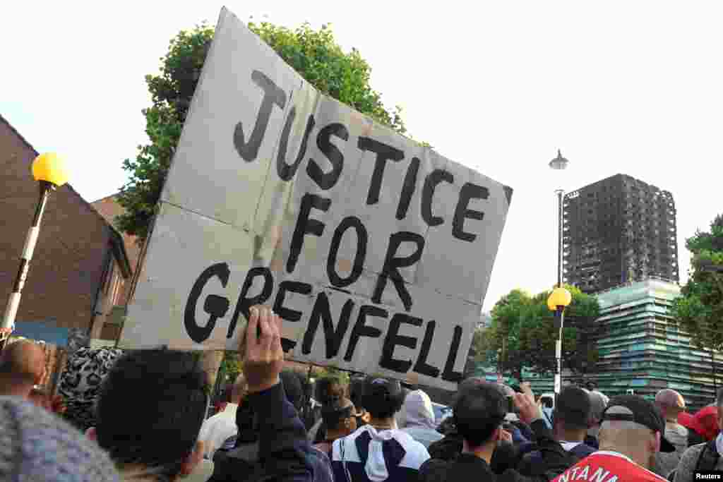 Protesters march towards The Grenfell Tower block that was destroyed by fire, in north Kensington, West London, Britain.