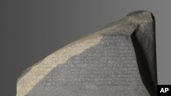 The Rosetta Stone from el-Rashid, Egypt. This artifact, which was created in 196 BC, unlocked Egyptian hieroglyphics.