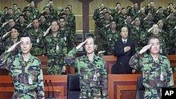 South Korea's Army Chief of Staff, Kim Sang-ki, center, salutes with other military members during the commanders meeting at the Army headquarters in Daejeon, south of Seoul, South Korea, 30 Dec 2010