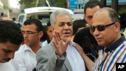 Hamdeen Sabahi waves to his supporters during protest against new judicial law in Cairo, May 25, 2013.