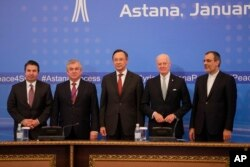 From left, Turkish Foreign Ministry Deputy Undersecretary Sedat Onal, Russia's special envoy on Syria Alexander Lavrentiev, Kazakh Foreign Minister Kairat Abdrakhmanov, UN Syria envoy Staffan de Mistura and Iran's Deputy Foreign Minister Hossein Jaber Ansari pose for a photo following the talks on Syrian peace in Astana, Kazakhstan, Jan. 24, 2017.