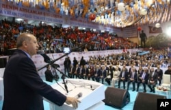 FILE - Turkey's President Recep Tayyip Erdogan addresses members of his ruling party in Ordu, Turkey, March 24, 2018. Erdogan has criticized anti-war students at Bosphorus University, calling them terrorists following a fight there.