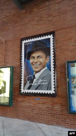 A poster of a US postage stamp depicting Frank Sinatra is seen on Dec. 8, 2015 at the entrance of the Hoboken Historical Museum in Hoboken, New Jersey.