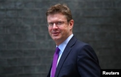 FILE - Britain's Secretary of State for Business Greg Clark arrives at Downing Street, London, Sept. 4, 2018.
