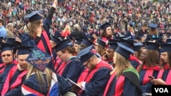 Some of the six thousand Liberty University graduates are seen in the school's football stadium for the Christian university's 44th commencement, in Lynchburg, Virginia, May 13, 2017. President Donald Trump will be speaking at the event. (C. Presutti/VOA)